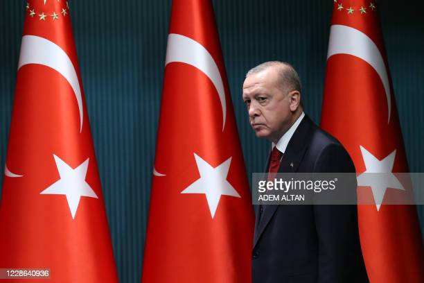 President of Turkey, Recep Tayyip Erdogan arrives to give a press conference after the cabinet meeting at the Presidential Complex in Ankara, Turkey,...