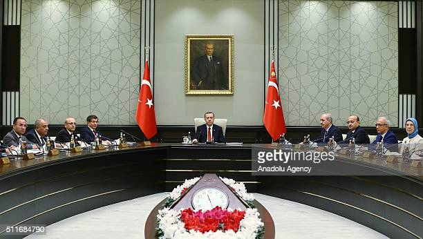 President of Turkey Recep Tayyip Erdogan chairs a cabinet meeting as Turkish Prime Minister Ahmet Davutoglu and other cabinet members participate at...