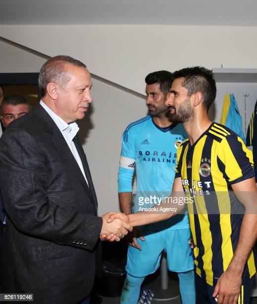 President of Turkey Recep Tayyip Erdogan congratulates Alper Potuk of Fenerbahce after the UEFA Europa League third qualifying round 2nd leg match...