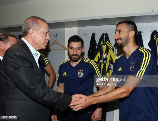 President of Turkey Recep Tayyip Erdogan congratulates football players of Fenerbahce after the UEFA Europa League third qualifying round 2nd leg...