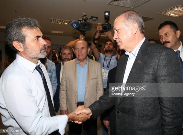 President of Turkey Recep Tayyip Erdogan congratulates Head Coach of Fenerbahce Aykut Kocaman after the UEFA Europa League third qualifying round 2nd...
