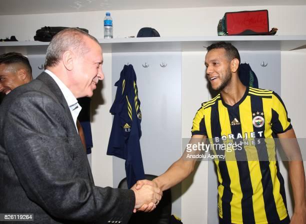 President of Turkey Recep Tayyip Erdogan congratulates Joseph De Souza of Fenerbahce after the UEFA Europa League third qualifying round 2nd leg...