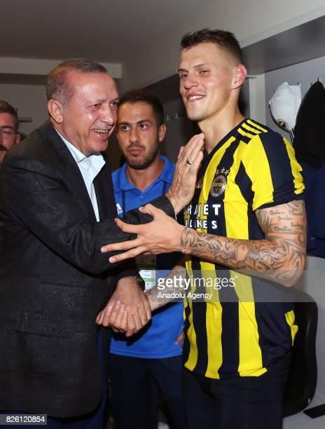 President of Turkey Recep Tayyip Erdogan congratulates Martin Skrtel of Fenerbahce after the UEFA Europa League third qualifying round 2nd leg match...