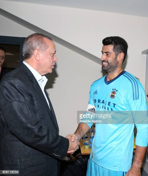 President of Turkey Recep Tayyip Erdogan congratulates Volkan Demirel of Fenerbahce after the UEFA Europa League third qualifying round 2nd leg match...