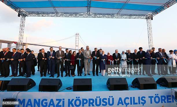 President of Turkey Recep Tayyip Erdogan cuts the ribbon with his wife Emine Erdogan Turkish Prime Minister Binali Yildirim his wife Semiha Yildirim...