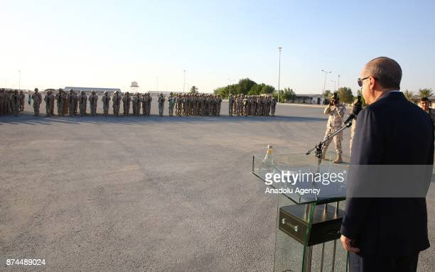 President of Turkey Recep Tayyip Erdogan delivers a speech during his visit at the QatariTurkish Armed Forces Land Command Base in Doha Qatar on...