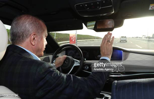 President of Turkey, Recep Tayyip Erdogan drives official car during the opening ceremony of North Marmara highway in Istanbul, Turkey on March 08,...