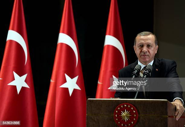 President of Turkey Recep Tayyip Erdogan gives a speech during an Iftar Dinner given for the Turkish presidency's personnels at Presidential Complex...