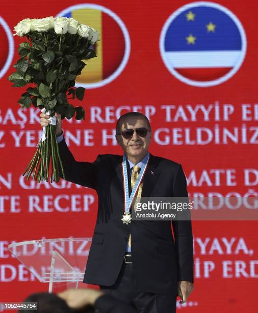 President of Turkey Recep Tayyip Erdogan greets people after Governor of the Autonomous Territorial Unit of Gagauzia Irina Vlah presented a Medal of...