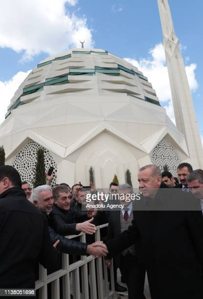 President of Turkey Recep Tayyip Erdogan greets people as he attends funeral ceremony of former Istanbul Chamber of Commerce president Atalay...