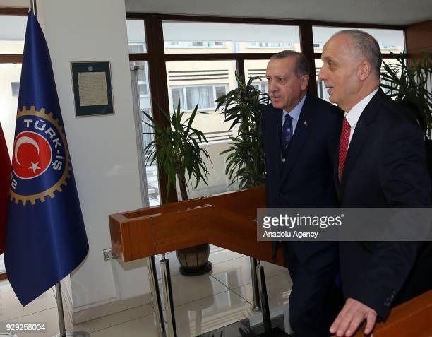 President of Turkey Recep Tayyip Erdogan is accompanied by President of TurkIs Ergun Atalay during President's visit to TurkIs Headquarters in Ankara...