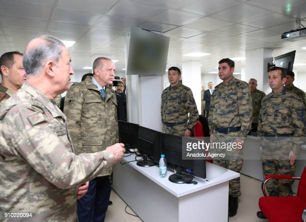 President of Turkey Recep Tayyip Erdogan is being informed as he is flanked by Chief of the General Staff of the Turkish Armed Forces Hulusi Akar...
