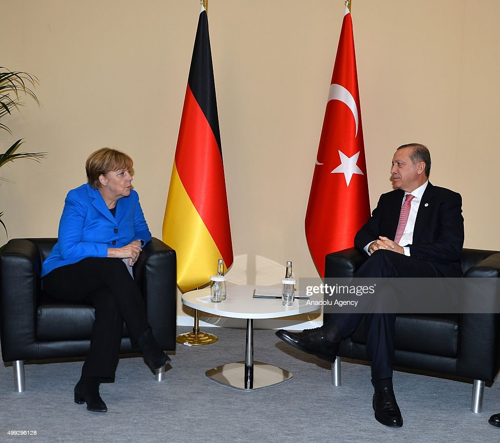 President of Turkey Recep Tayyip Erdogan (R) meets with German Chancellor Angela Merkel (L) on the sidelines of the COP21, United Nations Conference on Climate Change, in Le Bourget, north of Paris, France, on November 30, 2015.