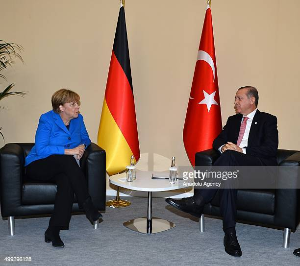President of Turkey Recep Tayyip Erdogan meets with German Chancellor Angela Merkel on the sidelines of the COP21 United Nations Conference on...