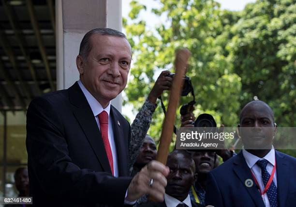 President of Turkey Recep Tayyip Erdogan plays a traditional drum during an official welcoming ceremony in Dar es Salaam Tanzania on January 23 2017