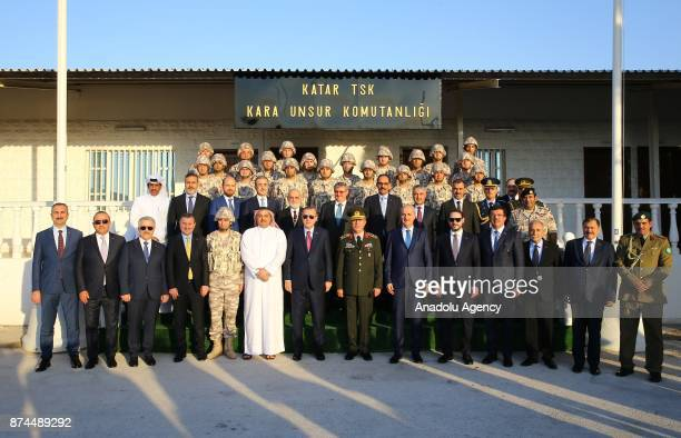 President of Turkey Recep Tayyip Erdogan poses for a photo with minister and soldiers during his visit at the QatariTurkish Armed Forces Land Command...