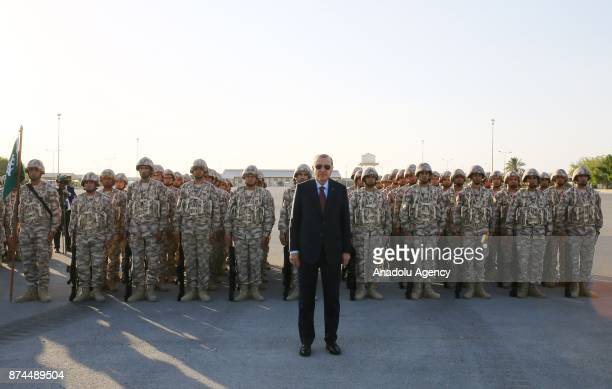 President of Turkey Recep Tayyip Erdogan poses for a photo with soldiers during his visit at the QatariTurkish Armed Forces Land Command base in Doha...