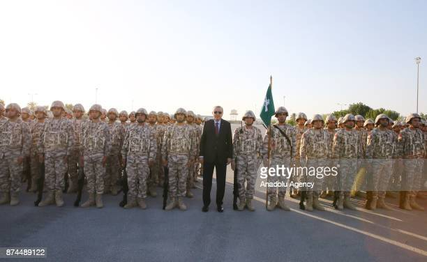 President of Turkey Recep Tayyip Erdogan poses for a photo with the soldiers at the QatariTurkish Armed Forces Land Command Base in Doha Qatar on...