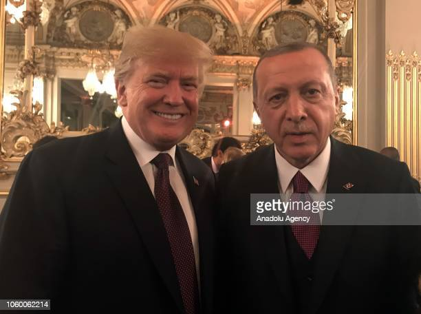 President of Turkey Recep Tayyip Erdogan poses for a photo with US President Donald Trump during a dinner hosted by French President for visiting...