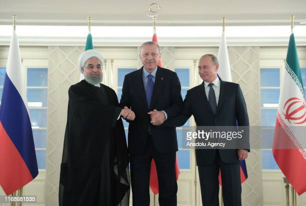 President of Turkey Recep Tayyip Erdogan , President of Russia Vladimir Putin and President of Iran Hassan Rouhani pose for a photo ahead of the...