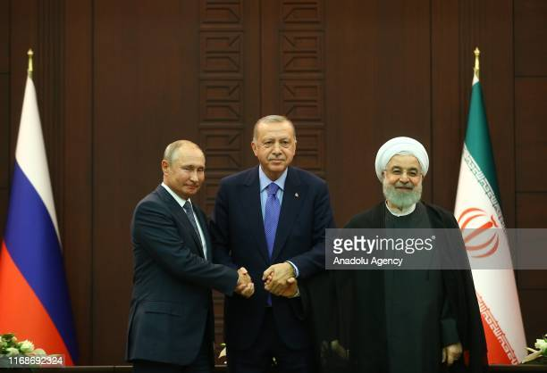 President of Turkey Recep Tayyip Erdogan , President of Russia Vladimir Putin and President of Iran Hassan Rouhani pose for a photo after the joint...