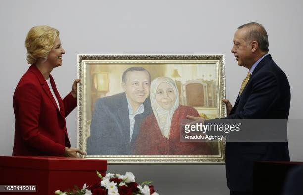President of Turkey Recep Tayyip Erdogan receives a framed image of him and his deceased mother Tenzile Erdogan from Governor of the Autonomous...