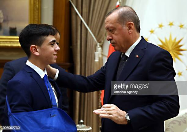 President of Turkey Recep Tayyip Erdogan receives Fawzi alJunaidi 16 years old youth who was manhandled and detained by Israeli soldiers and became...
