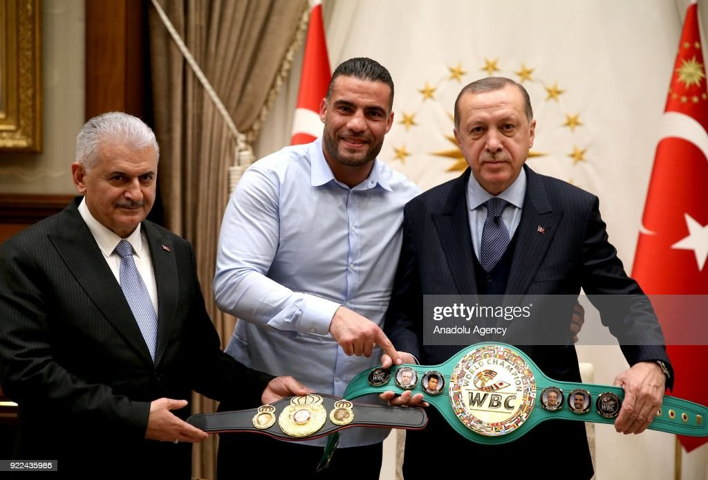 President of Turkey Recep Tayyip Erdogan (R) receives Syrian boxer Mahmut Omer Manuel Charr (C) at Presidential Complex in Ankara, Turkey on February 21, 2018. Turkish Prime Minister Binali Yildirim (L) also attended the meeting.