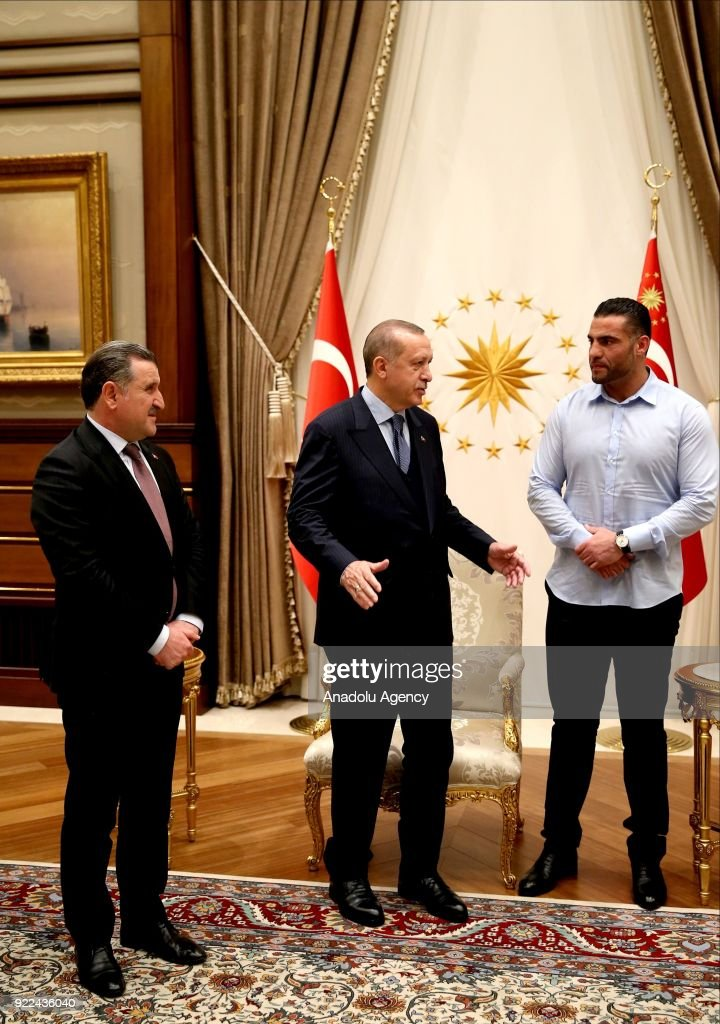 President of Turkey Recep Tayyip Erdogan (R) receives Syrian boxer Mahmut Omer Manuel Charr (C) at Presidential Complex in Ankara, Turkey on February 21, 2018. Turkish Youth and Sports Minister Osman Askin Bak (L) also attended the meeting.