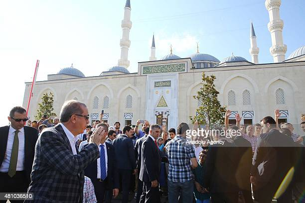 President of Turkey Recep Tayyip Erdogan salutes citizen as he leaves mosque after performing Eid alFitr prayer at Mimar Sinan Mosque in Istanbul...
