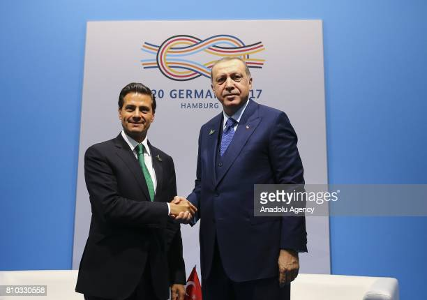 President of Turkey Recep Tayyip Erdogan shakes hand with Mexican President Enrique Pena Nieto before their bilateral meeting within the G20 Leaders'...