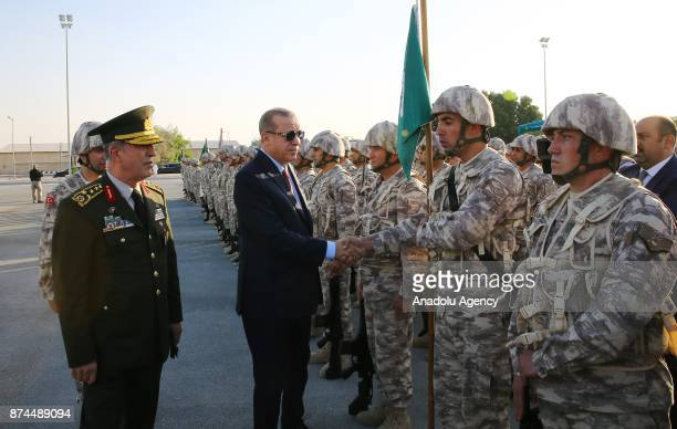 President of Turkey Recep Tayyip Erdogan shakes hands with a soldier as he is flanked by Chief of the General Staff of the Turkish Armed Forces...