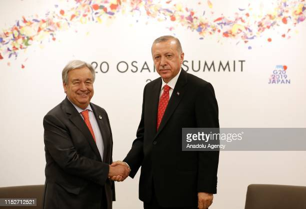 President of Turkey, Recep Tayyip Erdogan shakes hands with Secretary-General of the United Nations, Antonio Guterres during their meeting on the...