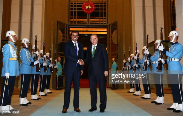 President of Turkey Recep Tayyip Erdogan shakes hands with Qatari Sheikh Tamim bin Hamad Al Thani at Presidential Complex in Ankara Turkey on...