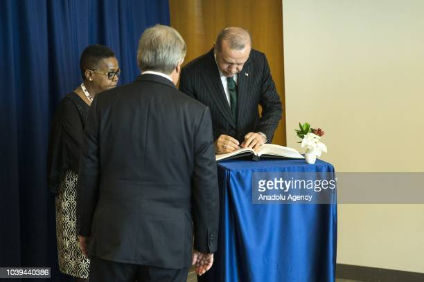 President of Turkey Recep Tayyip Erdogan signs a guest book after his hand shake with SecretaryGeneral of the United Nations Antonio Guterres ahead...