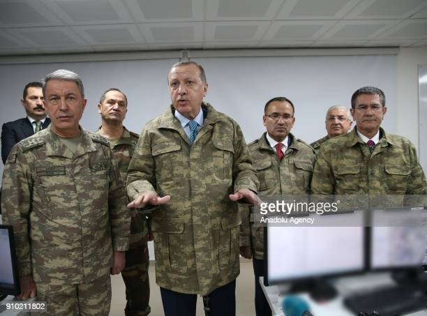 President of Turkey Recep Tayyip Erdogan speaks as he is flanked by Chief of the General Staff of the Turkish Armed Forces Hulusi Akar during his...