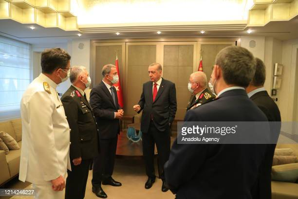 President of Turkey, Recep Tayyip Erdogan speaks with Turkish National Defense Minister Hulusi Akar , Chief of General Staff Gen. Yasar Guler ,...