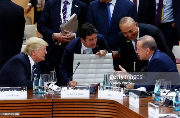 President of Turkey Recep Tayyip Erdogan talks with US President Donald Trump accompanied by Foreign Affairs Minister of Turkey Mevlut Cavusoglu...