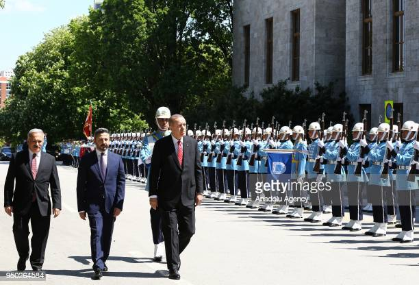 President of Turkey Recep Tayyip Erdogan views the honor guards as he arrives for a special session of parliament on the 98th anniversary of...