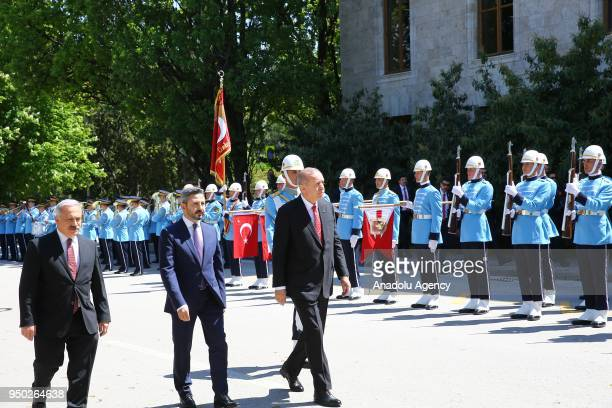 President of Turkey Recep Tayyip Erdogan walks past the honor guards as he arrives for a special session of parliament on the 98th anniversary of...