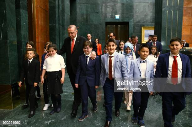 President of Turkey Recep Tayyip Erdogan walks with children during the National Sovereignty and Children's Day at the Presidential Complex in Ankara...