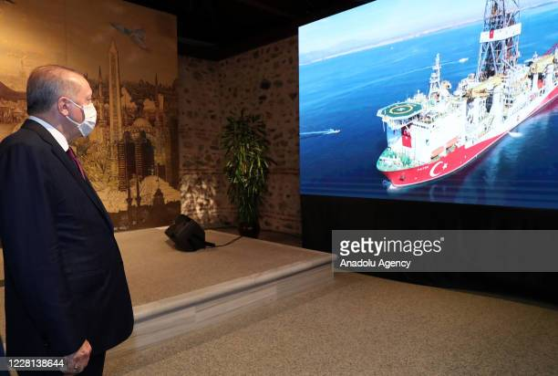 President of Turkey, Recep Tayyip Erdogan watches a briefing on the discovery of a major natural gas reserve off Black Sea coast during a press...