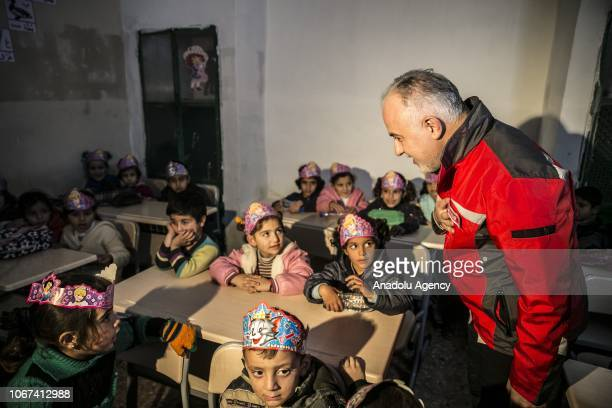 President of Turkish Red Crescent Kerem Kinik speaks with children during opening ceremony of a preschool established by Turkish Red Crescent at the...