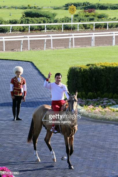 President of Turkmenistan Gurbanguly Berdimuhamedov rides a horse as he attends the opening ceremony of AkhalTeke Horse Beauty Contest within annual...