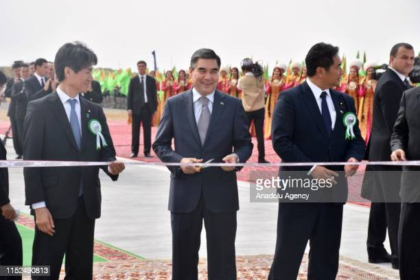 President of Turkmenistan Gurbanguly Berdimuhamedow cuts ribbon during opening ceremony of the gas-to-liquids plant for production of gasoline from...
