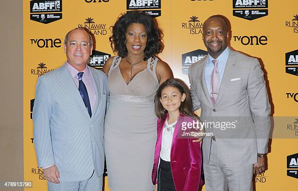 President of TV One network Brad Siegel actress Lorraine Toussaint daughter Samara and Film Life founder Jeff Friday attend the Runaway Island...