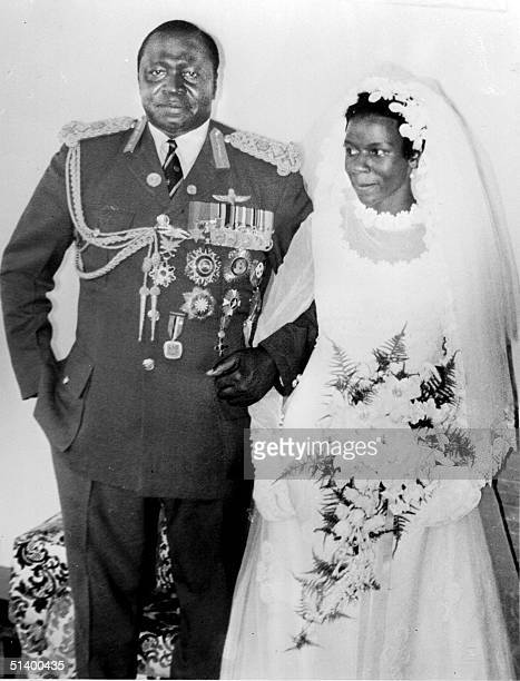 President of Uganda Idi Amin Dada poses with his new bride Sarah Kyolaba after their wedding in August 1975 in Kampala His reign of terror lasted...
