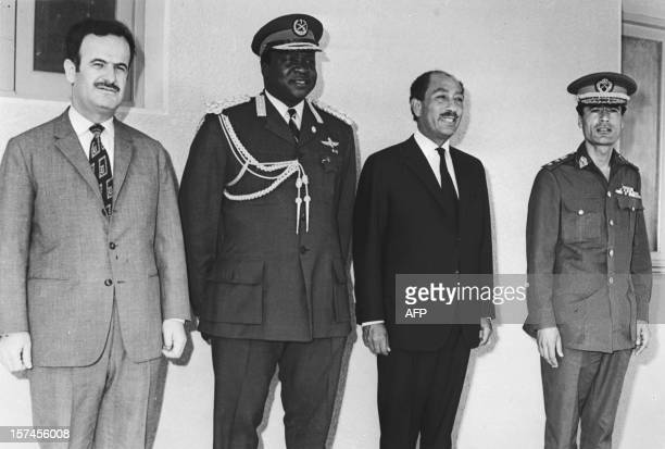 President of Uganda Idi Amin Dada poses with some of the Organization of African Unity Syrian President Hafez alAssad Egyptian President Anwar El...