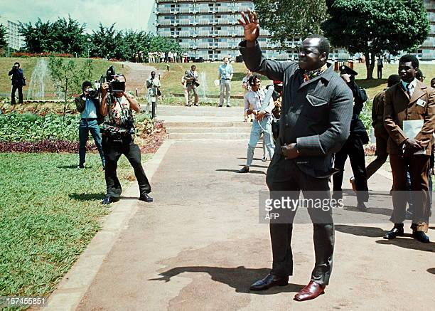 President of Uganda Idi Amin Dada waves to the media in July 1975 in Kampala during the Organization of African Unity summit Idi Amin's reign of...