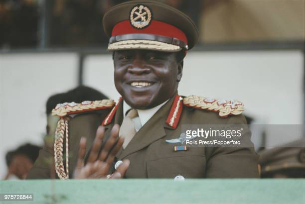 President of Uganda, Idi Amin pictured applauding at a military event in Kampala, Uganda in August 1972.